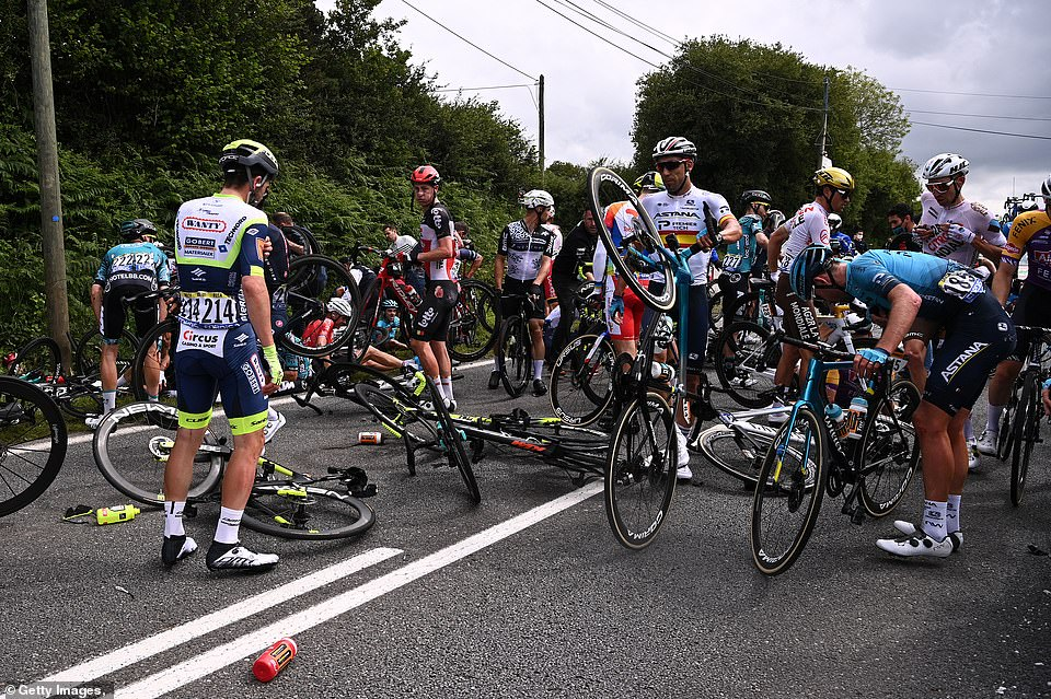 Riders survey the damage after the crash during the 108th Tour de France 2021, with many left bruised and battling injuries