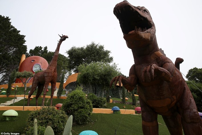 The multi-colored installations include a herd of 15-foot-tall dinosaurs in the backyard, as well as giant colorful mushrooms
