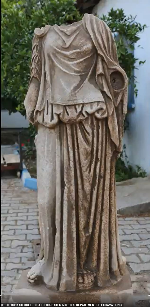 An 1,800-year-old sculpture of a robed woman was discovered in the ruins of Metropolis, an important trade post in West Turkey during the Roman Empire