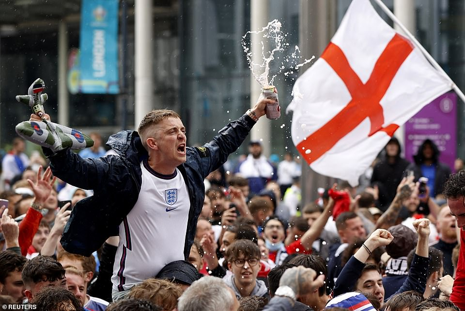 An England fan waves an inflatable Spitfire ahead of the blockbuster match against Germany in the Euros at 5pm
