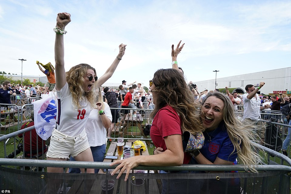 England fans celebrate during the UEFA Euro 2020 round of 16 match between England and Germany at the 4TheFans fan park in Manchester
