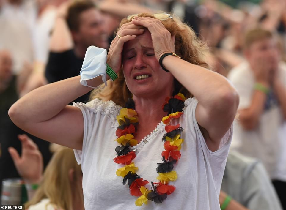 German fans react after their first loss to England in major tournament since 1966 World Cup