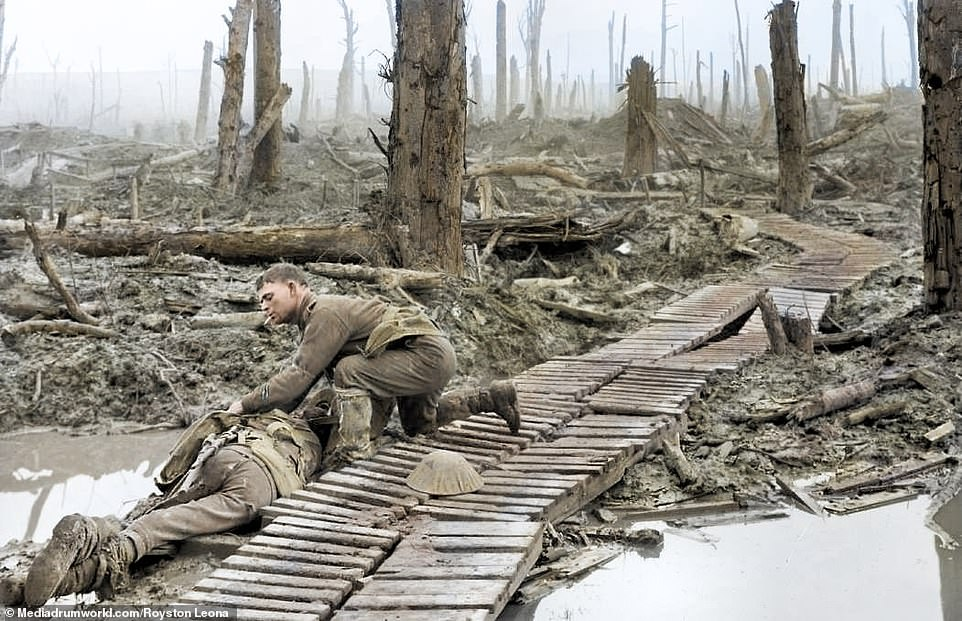 A soldier smokes a cigarette as he leans over the duckboards to tend to another man who is either dead or injured in July 1916.By the spring of 1916, things were looking grim on the Western Front. The French Army had already suffered 190,000 casualties at Verdun, with no sign of victory in sight. In desperation, they turned to their British allies to break the deadlock. An Anglo-French assault 125 miles north at the Somme, they reasoned, would relieve German pressure at Verdun, or 'the Mincing Machine', as fatalistic French soldiers called it.