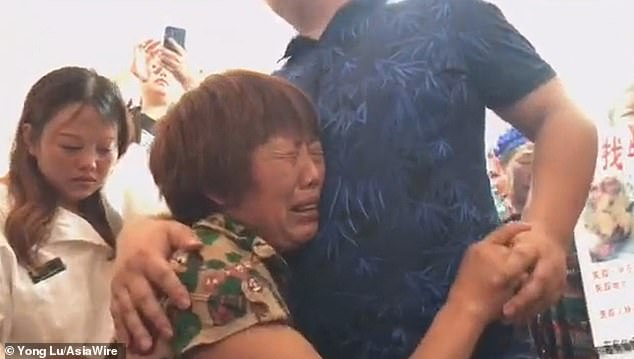 Three-year-old Tao and his mother Zhou Jiaying (pictured hugging having been reuinited) were abducted and sold to a family in the province of Shandong in 1990, by neighbours from the same village, according to the news site Baidu