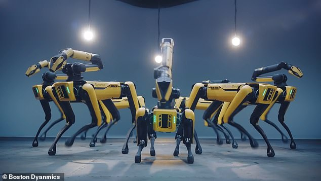 Funky: Seven units of the robotic dog Spot are seen performing a variety of impressive moves to K-pop band BTS's music in a new video released by Boston Dynamics