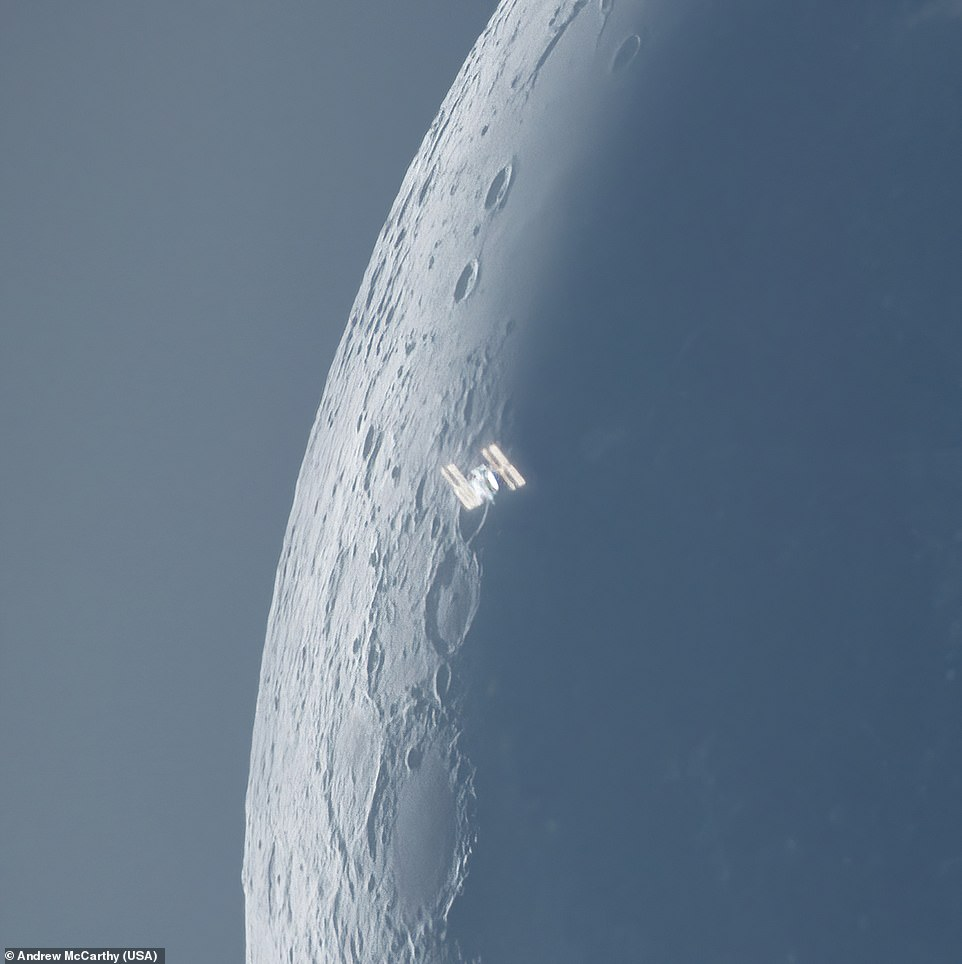 The iconic International Space Station is seen here transiting the Moon in an image captured during the day by Andrew McCarthy