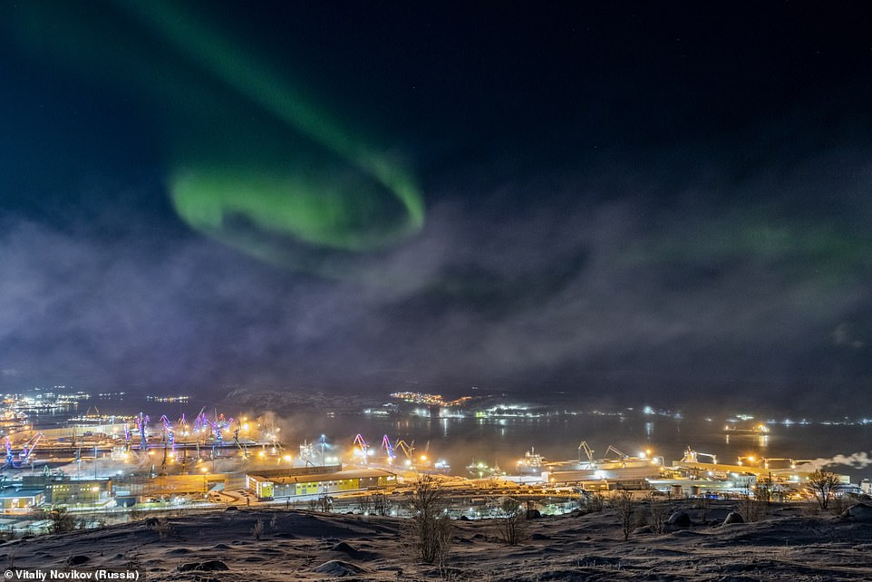Vitaliy Novikov took this picture of the Aurora Borealis in Murmansk, a difficult thing to capture due to the bright lights of the city