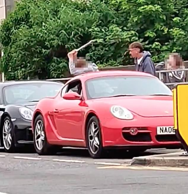 This is the moment a young man used a wrench to attack a Porsche Carrera GT which was parked on the side of the road in Dover, Kent