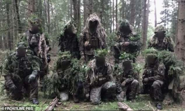 A band of men from Nordkreuz dressed up in camouflage suits as they practise manoeuvres in the woods