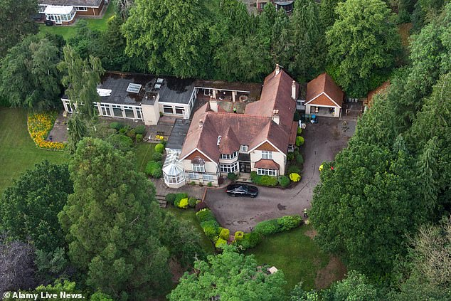 Today detectives and forensics teams could be seen combing for clues at the gated mock Tudor house, which has five beds, four reception rooms and an indoor swimming pool