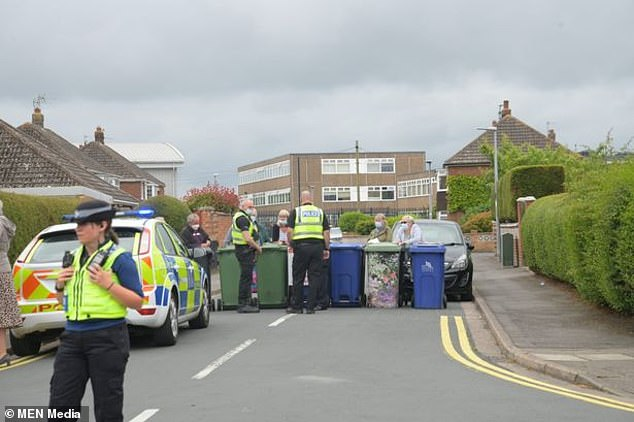 At the end of the school day, they gathered to place wheelie bins across the entrance to the cul-de-sac near Sandringham Road. Pictured: The protest