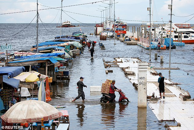 However, a production model shows the population living on at-risk land will increase to 410 million people.72 percent in the tropics and 59 percent in tropical Asia alone (Pictured is flooding in Indonesia last year)