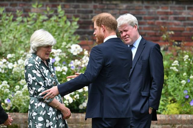 Family time: Prince Harry chats to his aunt Lady Jane Fellowes and uncle Earl Spencer at the unveiling of the statue