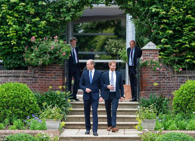 William and Harry smile as they enter theSunken Garden at Kensington Palace on what would have been their mother's 60th birthday