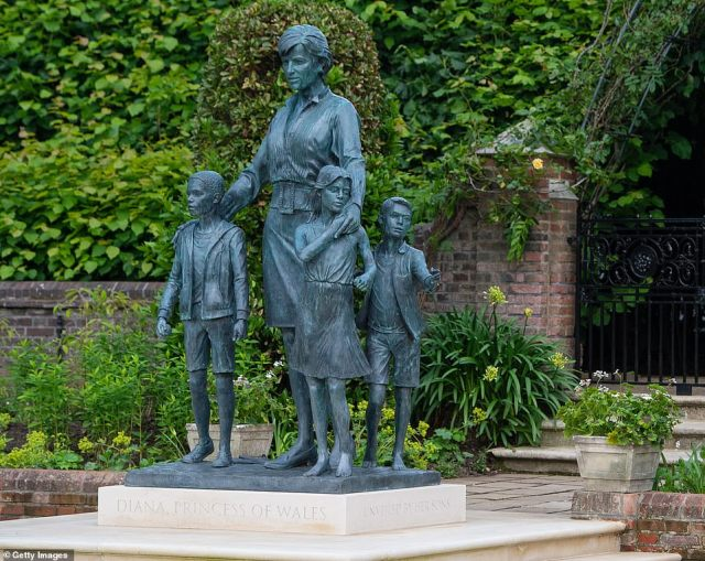 But rather than depict her with her sons as she appeared in the card, she is posed with three children - two of whom aren't wearing shoes. The palace said 'it represents the universality and generational impact of The Princess' work'
