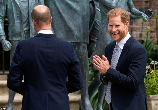 Harry beamed as he looked around the sunken garden in Kensington Palace after the statue of his mother was unveiled