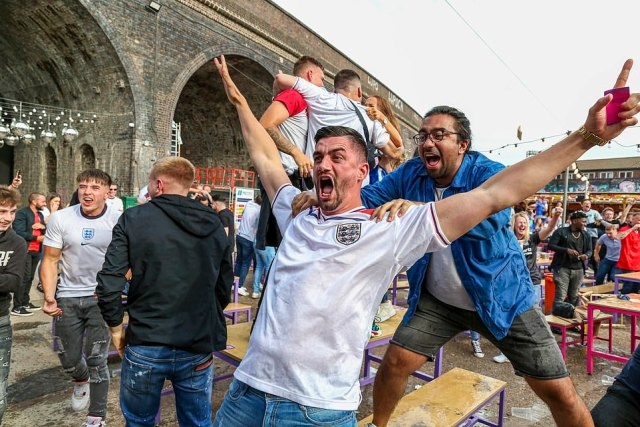 England football fans celebrate the opening goal in the England vs Germany game at the Luna Springs in Digbeth, Birmingham. The England fans will have to continue watching from a beer garden for the match on Saturday against Ukraine in Rome