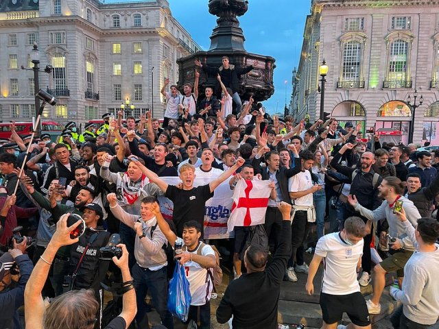 LONDON: Fans were seen celebrating in Leicester Square after England's win. People clutched flags and wore jerseys as they cheered