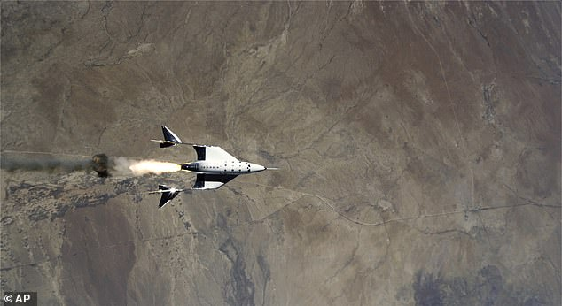A photo shows the release of VSS Unity from VMS Eve and ignition of rocket motor over Spaceport America, New Mexico