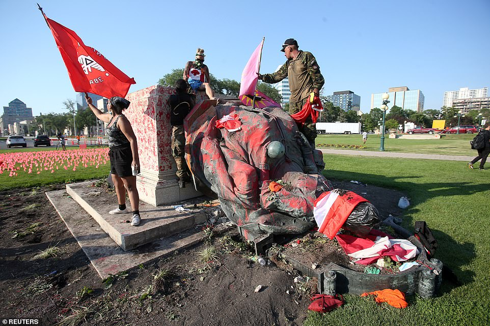 The defaced statue after being toppled during a rally, following the discovery of the remains of hundreds of children at former indigenous residential schools, outside the provincial legislature on Canada Day in Winnipeg