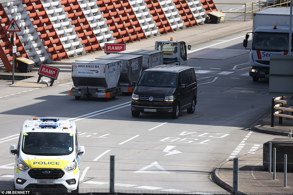 A black 2019 Volkswagen Caravelle was driven from Frogmore Cottage and onto the tarmac (pictured) at London's Heathrow Airport