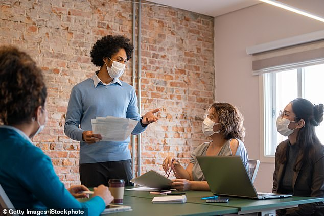 CDC researchers simulated a conference room in which there was one COVID-19-infected meeting participant, an uninfected speaker and two other participants (file image)