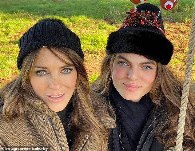 Lookalikes: After an 18-month relationship with Bing, Liz gave birth to her son Damian in 2002