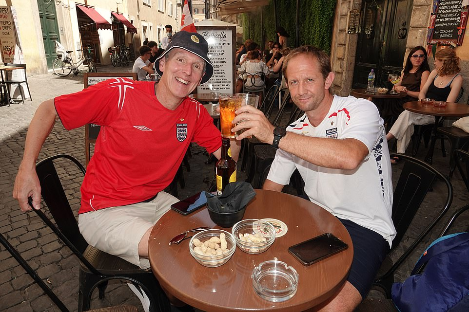 James Hughes and Matthew Dexter get on the beers in Rome, Italy, as they loosen up for the big England match on Saturday night