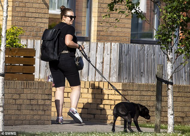 'Peru Two' drugs mule Melissa Reid is barely recognisable as she is spotted walking her dog near her home (pictured) - one day before her accomplice Michaella McCollum's BBC documentary airs
