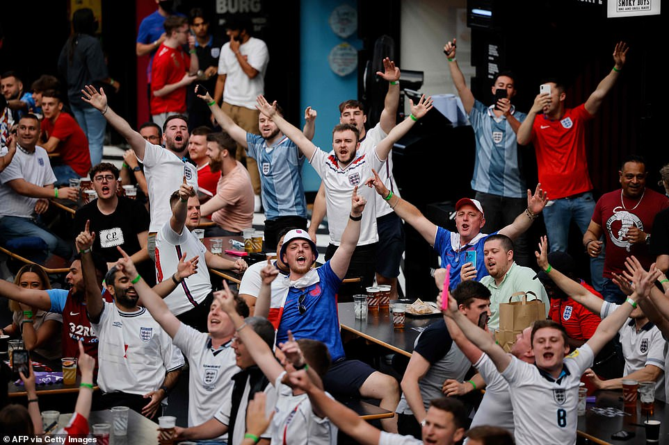 England supporters chant at the Boxpark Croydon in south London as England prepare to face Ukraine in UEFA
