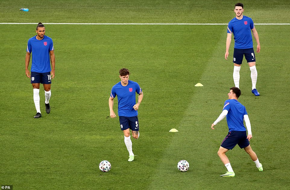 John Stones (centre), Mason Mount (front right) and Declan Rice Warm up prior to the UEFA Euro 2020 Quarter Final match at the Stadio Olimpico, Rome