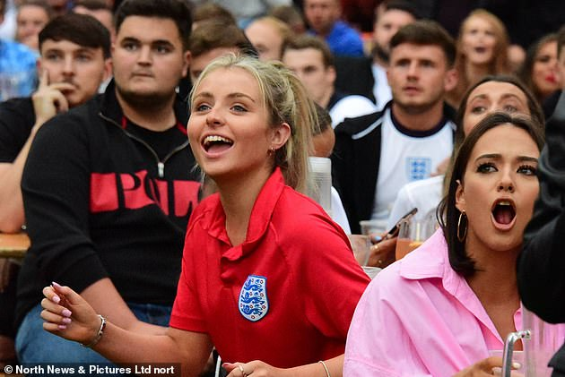 Supporters in fan zones across the country enjoyed a brilliant evening as England progressed to the next stage of Euro 2020. Above: Fans cheer in Newcastle's Times Square