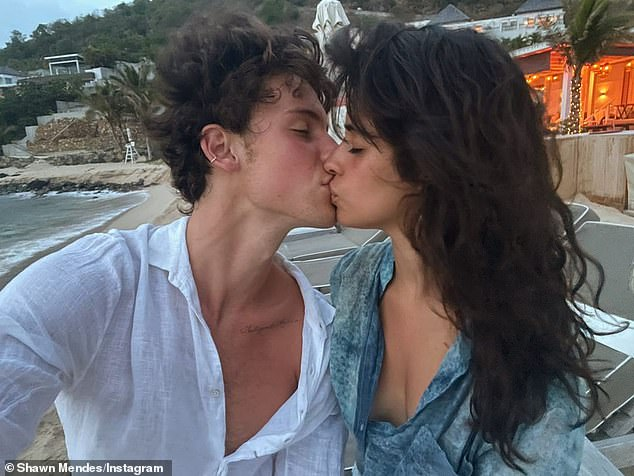 Love is in the air!Shawn marked the couple's anniversary with a tender Instagram post last week, sharing a snap of them kissing on the beaches of the Caribbean and writing: 'Happy '2 years my baby'