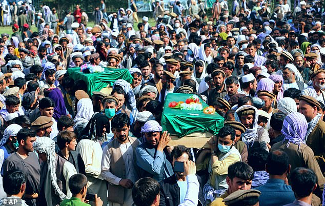 Afghans carry the body of civilians killed during fighting between the Taliban and Security forces, during their funeral, in Badakhshan province, northern Afghanistan, Sunday