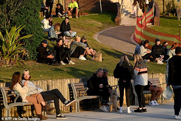 Sydneysiders are pictured soaking up the sun on July 6 in Bondi despite being in lockdown - which will now continue until at least July 16