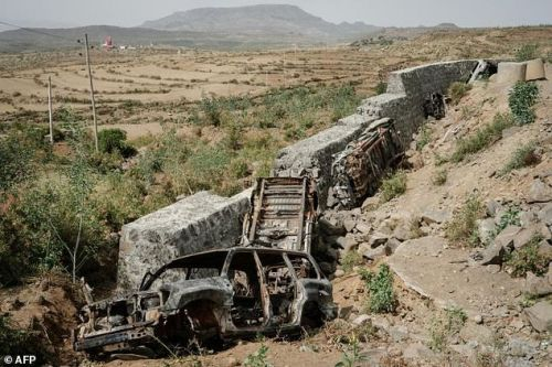 The wreckage of cars from an alleged Eritrean army convoy attacked by Tigray Defence Forces are seen in a ditch beside the road near Adiaweso, southwest of Mekele in Tigray region, Ethiopia, on June 20, 2021