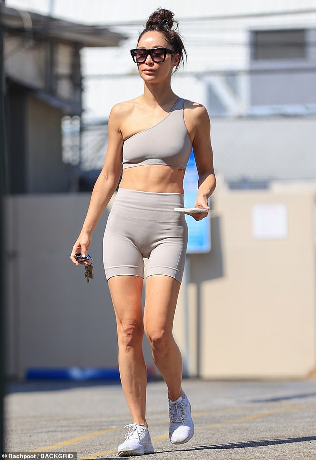 Taut and toned: Cara Santana was seen flaunting her fit physique while heading on a post-workout coffee run in Los Angeles on Tuesday