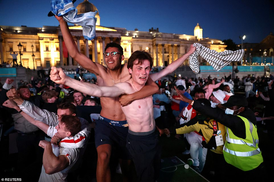 These two fans removed their shirts in celebration at the Trafalgar Square fan zone in celebration last night