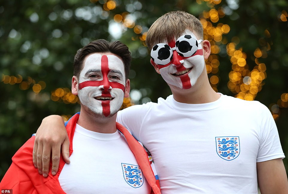 Humans aren't the only species to paint their faces. In fact, many birds are known to slap on 'natural makeup' for various reasons — from displays of dominance to increasing the colour or their plumage and even camouflage. Pictured: Two English football fans seen in Bristol donning face paint prior to the Euro 2020 match between England and Ukraine on July 3, 2021