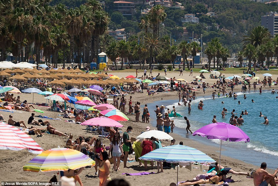Quarantine-free holidays are set to be unlocked for millions of families to more than 130 countries – including the US, Thailand and Spain (pictured, Malaga)