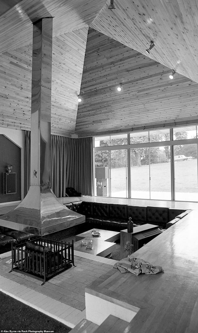 After milling around outside the property at the party, Byrne decided to look inside.'The one thing that is striking when you walk in immediately is the main room, which has got this high pyramid shape, sunken floor, which makes it look even taller, surrounded by walls of glass and you're just looking out to the woods, basically,' he recalled of the interior seen above. 'What I thought was unusual was it was a housewarming and there was nothing really personal in the house that I could kind of see ¿ there was no personal photos, there were some books and stuff like that'