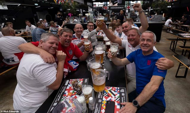 England fans pose for photos over pints of beer atBOXPARK Wembley ahead of tonight's Euro 2020 clash against Italy