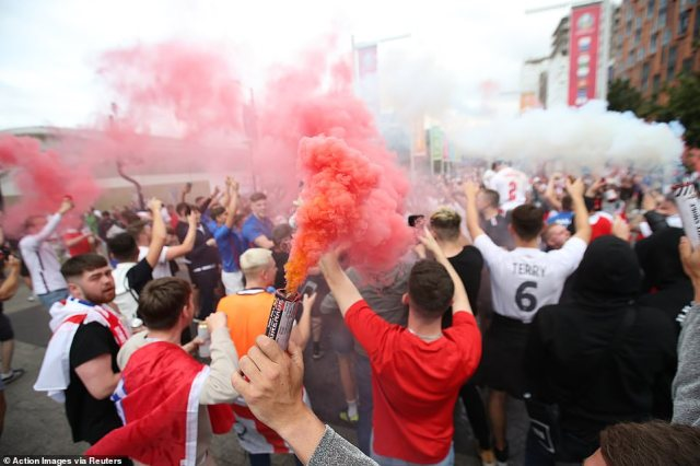 England fans with flares gather on Wembley Way outside Wembley Stadium ahead of the Euros clash tonight