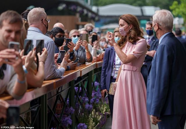 Kate Middleton at Wimbledon today crossing her fingers ahead of the Euros final against Italy at Wembley