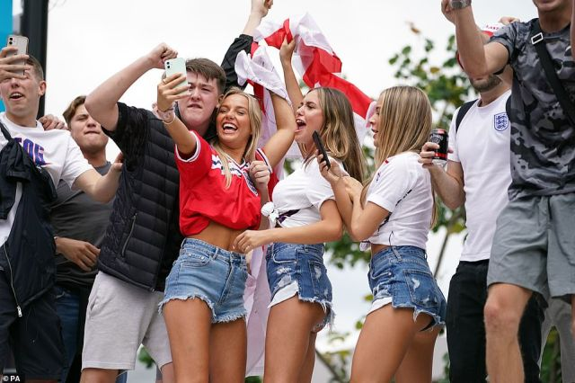England fans on top of a bus outside Wembley Stadium as the grounds turn chaotic ahead of the Euros final