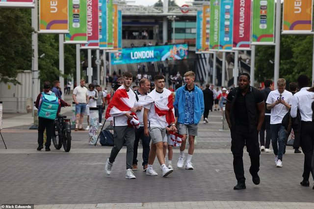 The first England supporters head to Wembley sporting red, white and blue ahead of the Euro 2020 final
