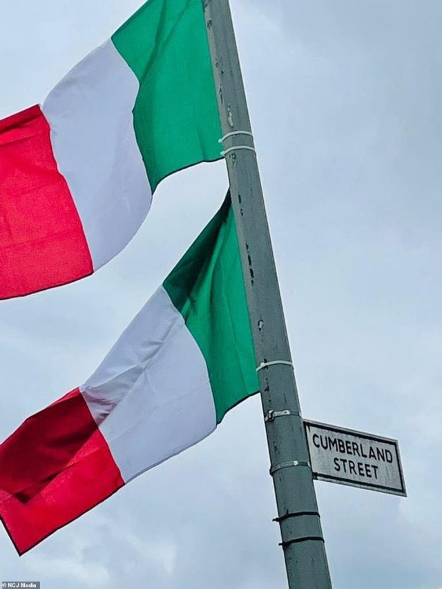 The Brazen Head, on the city's Catchcart Road, has left passersby in no doubt of where their allegiances lie with huge Italian standards across the pub and even on a lamppost