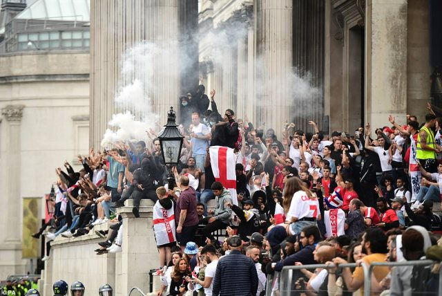 Fans let of smoke canisters and sing songs on the steps of the National Gallery at Trafalgar Square, Londo