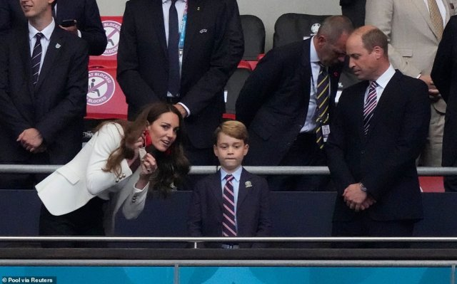 The Duchess of Cambridge leaned down to chat to Prince George ahead of the match at Wembley tonight