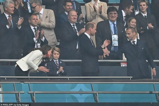 The Duchess of Cambridge leaned down to speak to her son as Prince William chatted to UEFA President Aleksander Ceferin